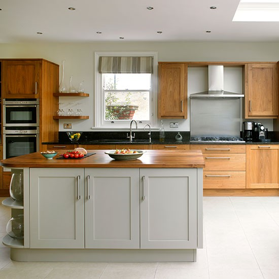 Traditional kitchen with painted grey and plain wood units kitchen