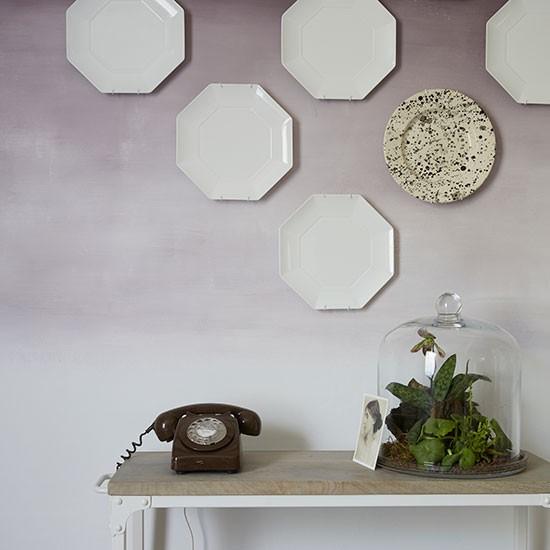 pale purple hallway with plates wall display hallway