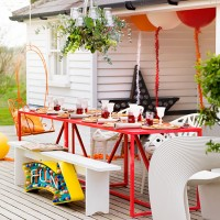 Garden decking with colourful party table