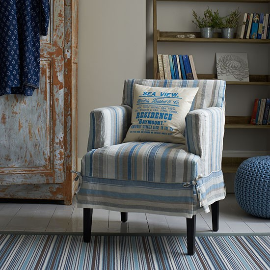 blue striped living room with armchair living room