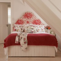 Bedroom with red floral headboard