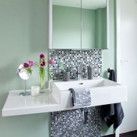 Green bathroom with mosaic tiling