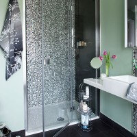 Green bathroom with mosaic tile shower