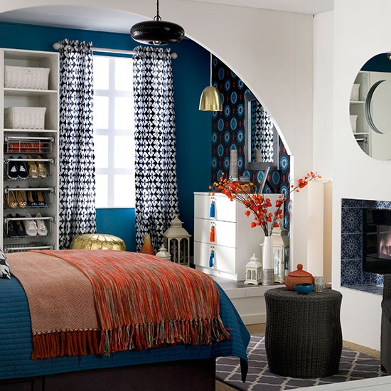Blue Bedroom With Orange Accents