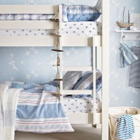 Blue coastal-style boys' room with bunk beds