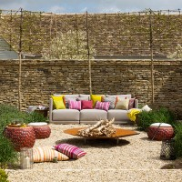 Walled garden with sofa and fire pit