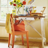 Country home office with orange chair