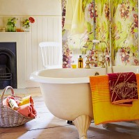 Vibrant country bathroom with floral shower curtain