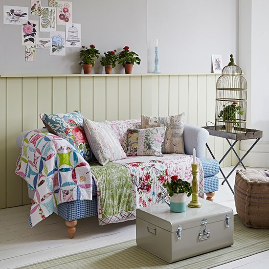 Country living room with patchwork throw | Living room decorating ...