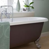 Mint green bathroom with roll-top bath