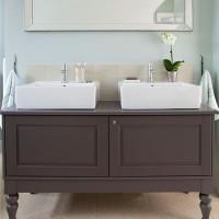 Mint green bathroom with vanity unit