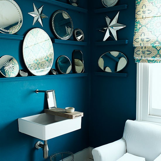 Blue bathroom with mirror display