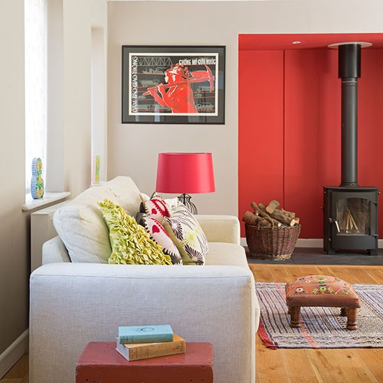 Cosy living room with red feature wall living room for Front room feature wallpaper