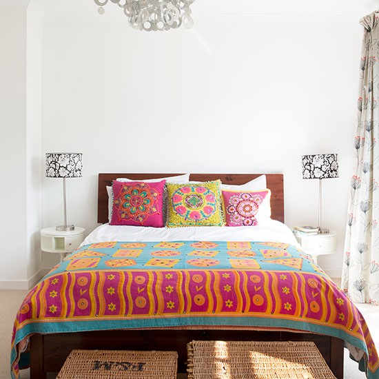 small but vibrant ethnic style bedroom small bedroom