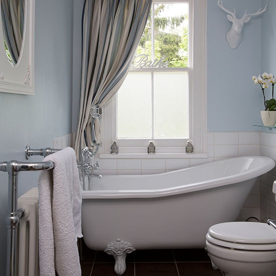 Pale blue bathroom with slipper bath bathroom decorating Tiny bathroom designs uk