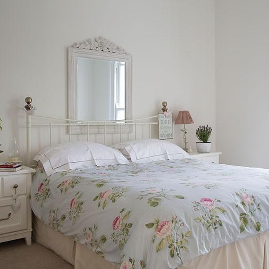 White bedroom with rose pattern bedlinen bedroom for Rose decorations for bedroom