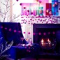 Modern Christmas living room with white fireplace, purple chair and pink pom pom Christmas decorations