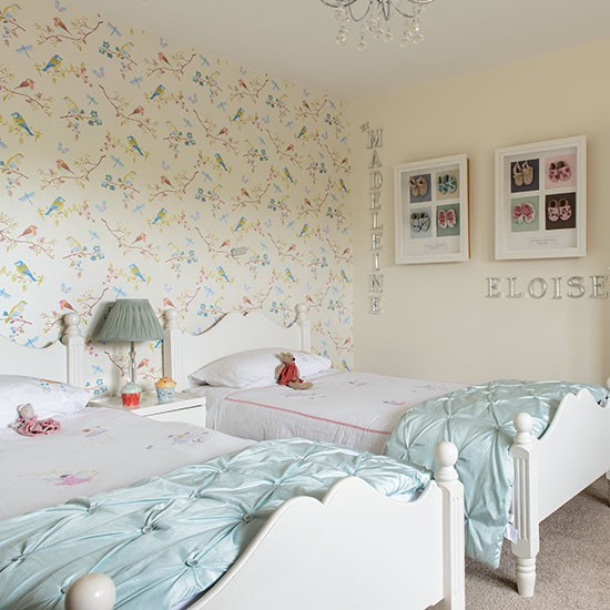 this girls 39 bedroom is decorated with wallpaper in a birds and