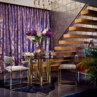 Modern dining room with purple damask curtain