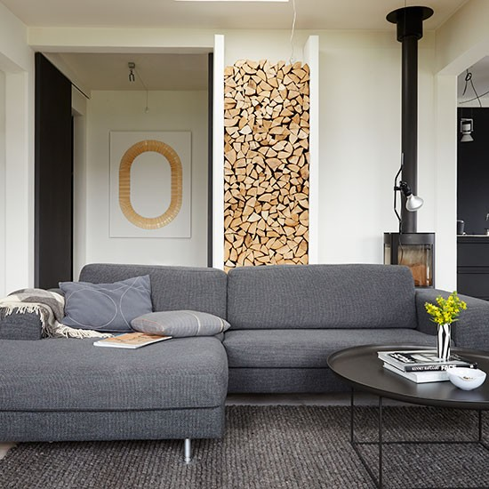 modern living room with grey sofas and wood pile living room