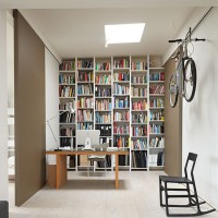 Home office with floor to ceiling shelves