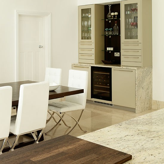 This open plan kitchen diner has an informal dining area a dresser