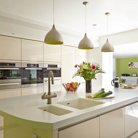 Modern white kitchen with island and pendant lights for Contemporary kitchen pendant lighting