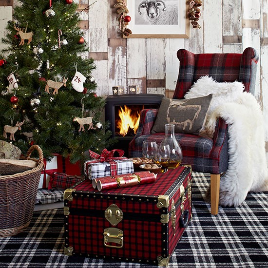 Country Christmas living room with checked carpet, tartan wing chair, tartan trunk and Christmas tree