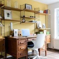 Yellow home office with wood furniture