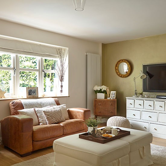 Neutral living room with white and leather furniture for Neutral lounge decorating ideas
