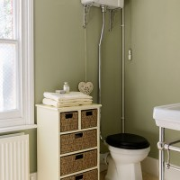Sage green and cream bathroom