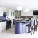 Check out this vibrant modern kitchen