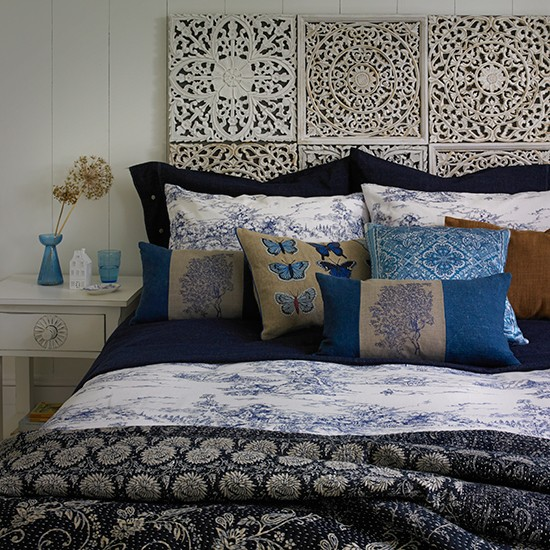 Bedroom with carved wooden headboard traditional bedroom for Bedroom ideas with no headboard