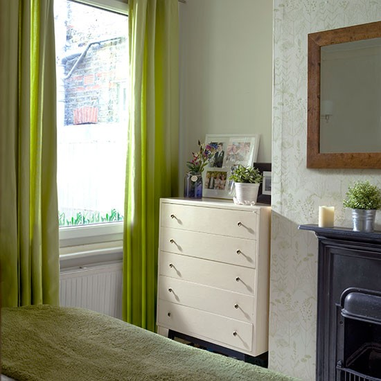 traditional bedroom with green curtains bedroom