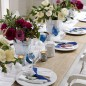 Dining table with table runner and Christmas rose display