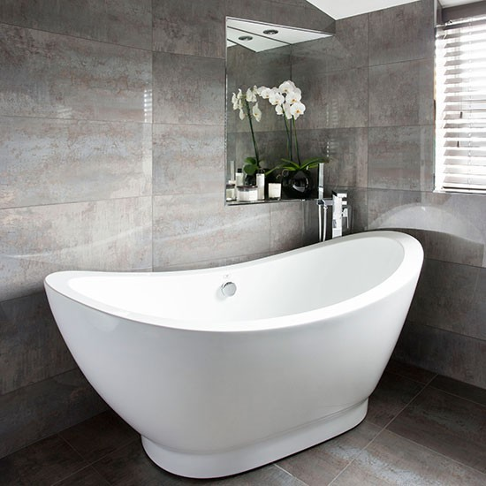 Grey bathroom with slipper bath decorating housetohome for Gray bathroom pictures