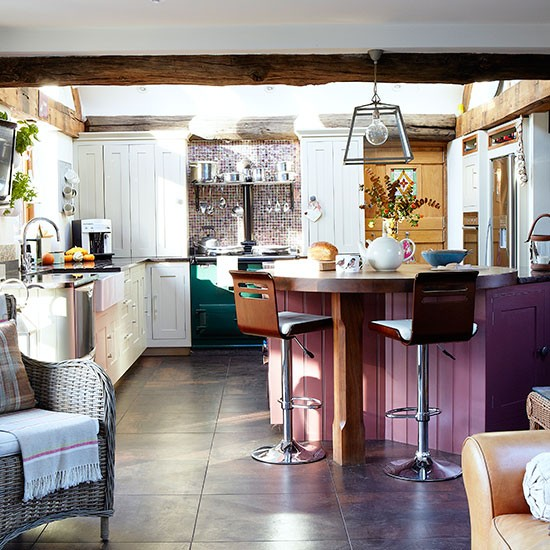 White Country Kitchen With Hits Of Purple And Green