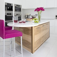 Step inside a white hi-gloss kitchen with pink accents