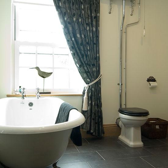 Traditional bathroom with roll top bath bathroom for Roll top bathroom ideas