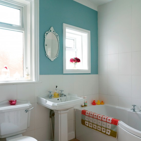 Compact bathroom with colourful feature wall small for Small family bathroom ideas