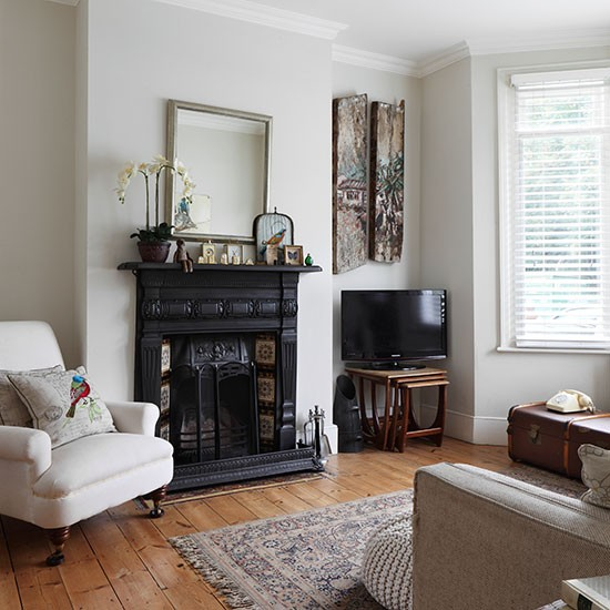 Neutral living room with traditional fireplace for London living room ideas