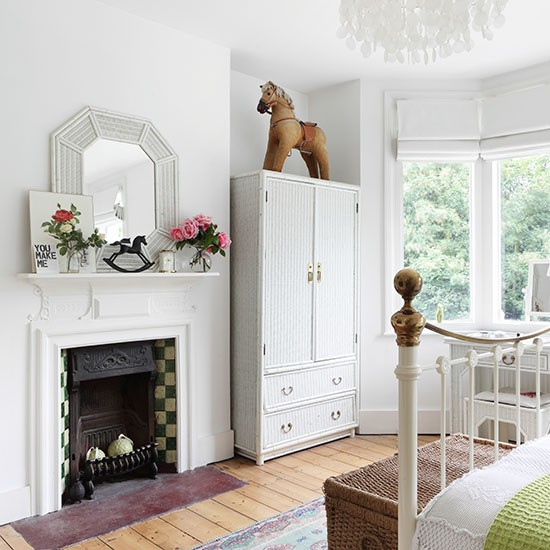 White bedroom with traditional fireplace white bedroom Bedroom fireplace ideas