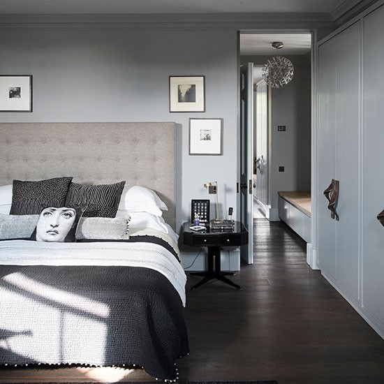 Tonal grey bedroom with dark wood floor decorating for Bedroom ideas dark wood floor