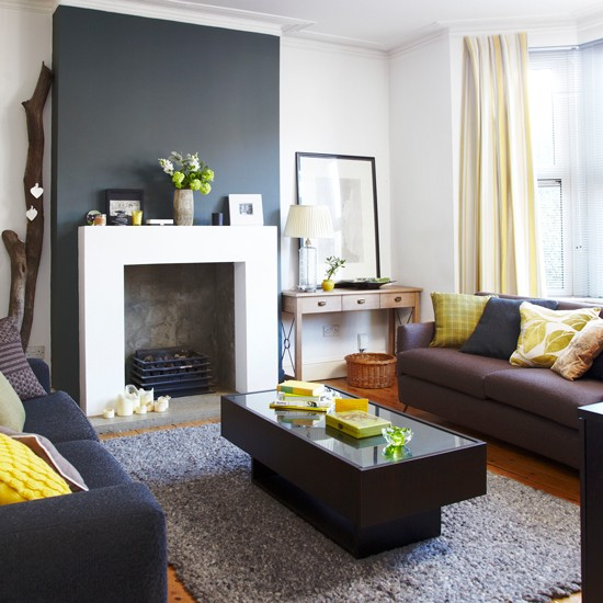 Dark grey living room with splashes of yellow how to for Black grey living room