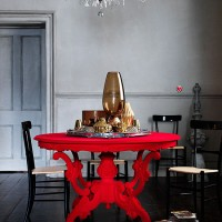 Grey dining room with bold red table