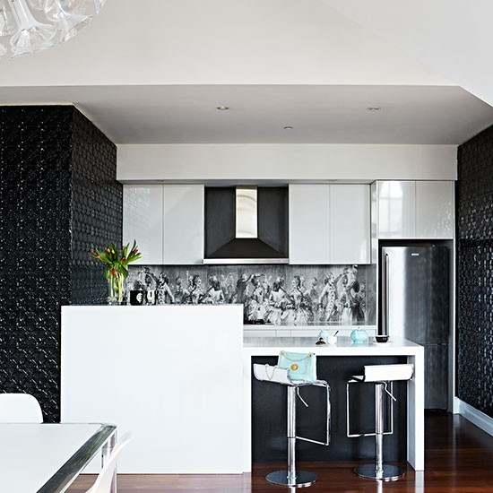 black and white kitchen with feature splashback