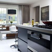 Step inside this modern blue-black kitchen