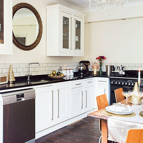 How Much Are Granite Worktops : This classic cream scheme with black granite worktops and dining table ...