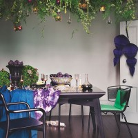 Modern dining room with living plant chandelier