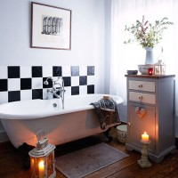 Pale grey bathroom with freestanding bath
